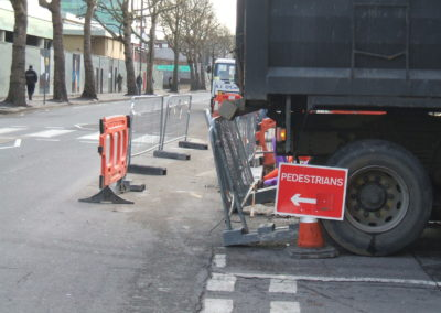 Lorry reversing onto safety barrier